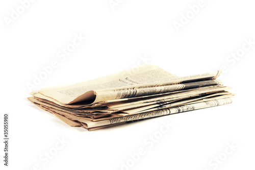 Leinwanddruck Bild pile of ancient newspapers