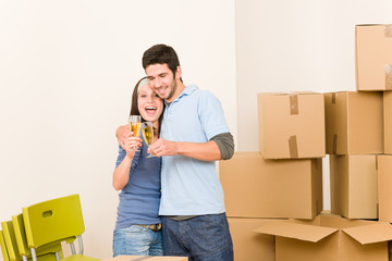 Moving into new home young couple toast