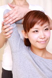 young japanese woman receives chiropractic poster