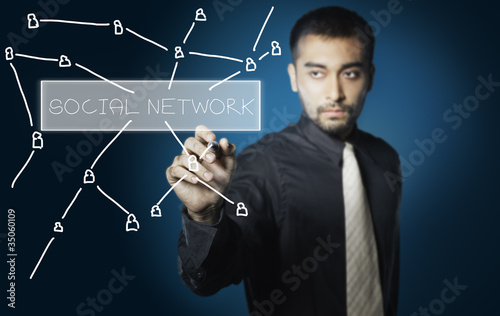 business man drawing social network on screen