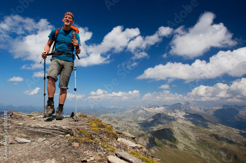 Young hiker enjoying mountain trekking