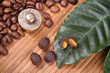 Roasted coffee beans and fruits with leafs