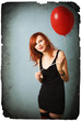 Vintage portrait of redhead girl with heart balloon.