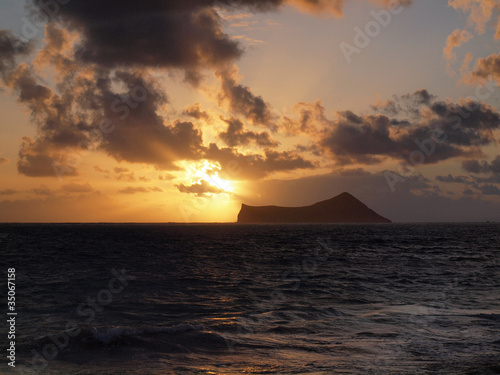 Sunrise next Rabbit Island over Waimanalo Ba