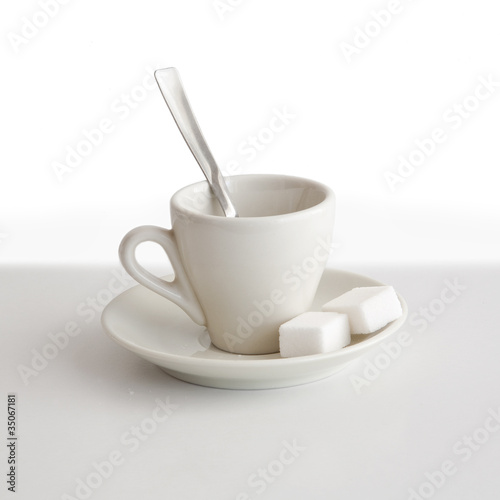 aA cup of coffee with sugar, please