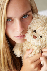 Unhappy teenage girl with cuddly toy