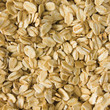 Oatmeal background, rolled raw oats macro closeup