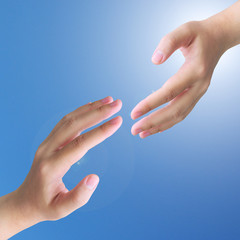 two hand touch isolated on blue sky