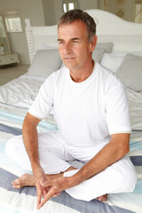 Mid age man in lotus position