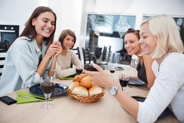 Smiling friends at dining table