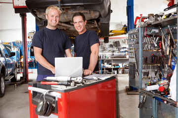 Portrait of smiling mechanics