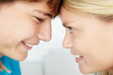 Teenage boy and girl close up profile