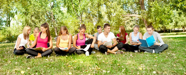 group of young students  in park
