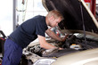 Mechanic Fixing Car