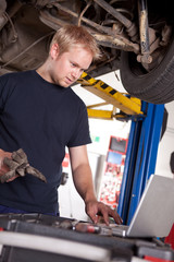 Auto Mechanic with Laptop
