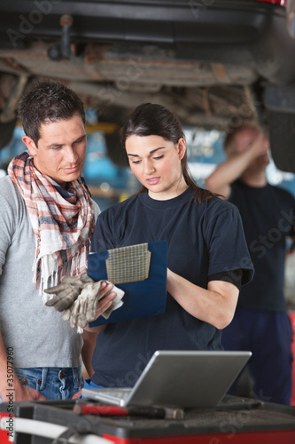 Female Mechanic Explaing Repairs to Client