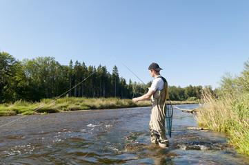 Angler am Fluß