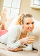 Young happy smiling woman drinking orange juice