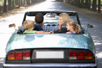 family in sports car