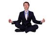 Business man in studio meditating
