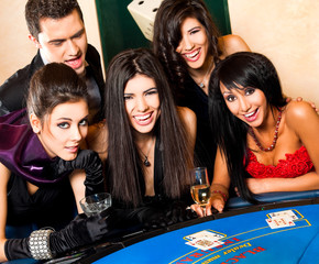 Young people behind black jack table