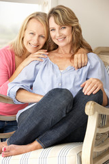 Adult mother and daughter at home