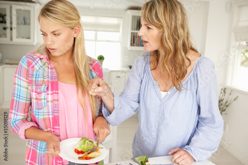 Mother and teenage daughter arguing about housework