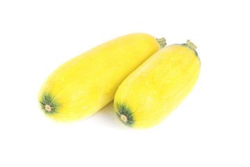 two whole and freshly  zucchini  isolation  on white