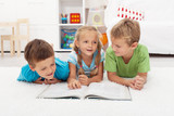 Fototapety Kids practice reading and story telling