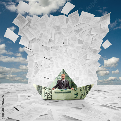Businessman in money boat under wave of documents
