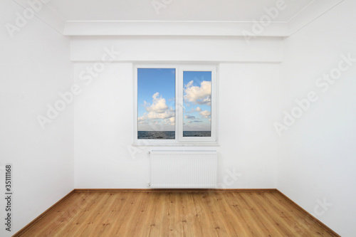 Small white room with sea view window