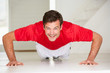 Man doing push-ups in home gym