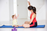 Fototapety Mother and baby doing yoga