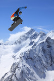 Snowboarder, jump in high mountains