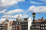Buildings and St Nicholas Church in Amsterdam
