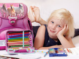 Fototapety Cute blond child is proud to start at school