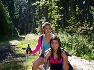 teenagers in the forest with nordic walking poles