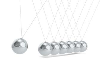 Pendulum. Newtons cradle White floor. Steel Balls.