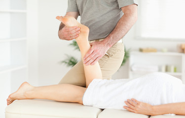 A woman's leg being massaged