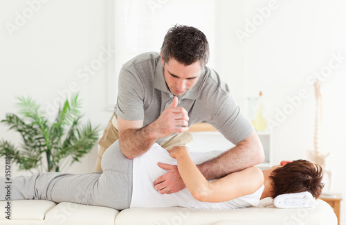 Masseur massaging female customer