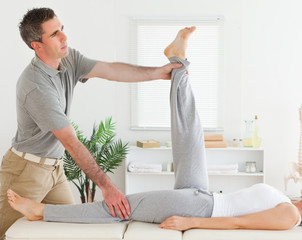 Chiropractor exercising with a customer