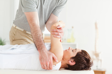 Man stretching a woman's arm