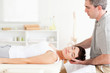 Chiropractor stretching a charming woman