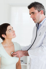 Doctor examining a charming woman