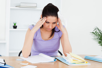 Stressed young woman accounting
