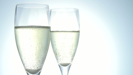 two glasses of bubbling champagne