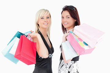Well-dressed women with shopping bags