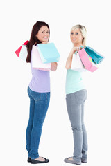 Gorgeous women with shopping bags