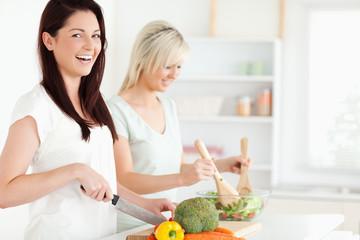 Laughing Women preparing dinner