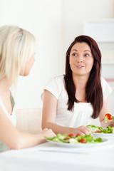 Portrait of amazed Women eating salad